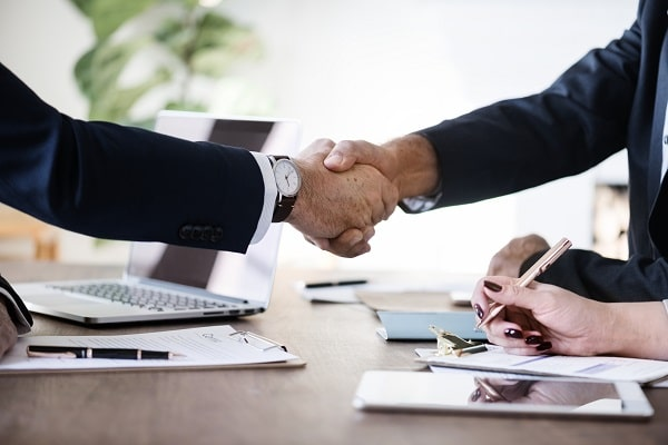 two business people shaking hands over a deal