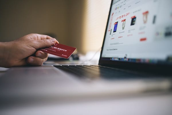 business customer holding credit card and shopping online